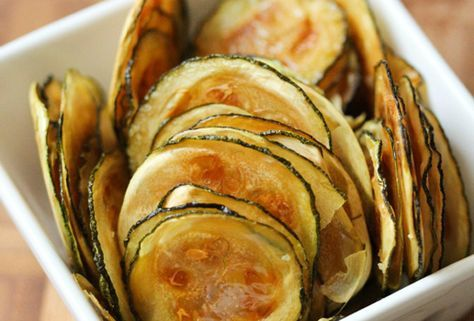 Zucchini chips: Coat them with olive oil and sprinkle on some salt or desired seasoning, and you're ready for a spin through the oven.