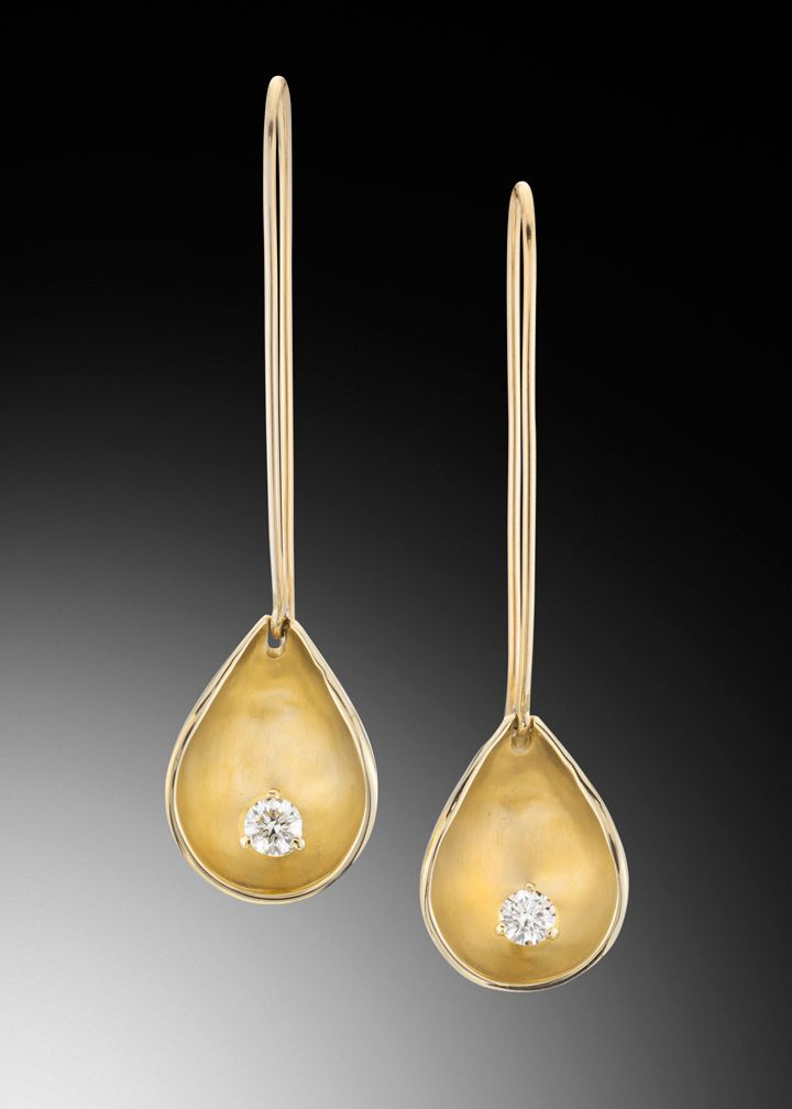 L'aqua ~ Liquid luxury. These droplet shaped earrings are fashioned from 14kt yellow gold encircling .33 carats total weight of VS G diamonds.