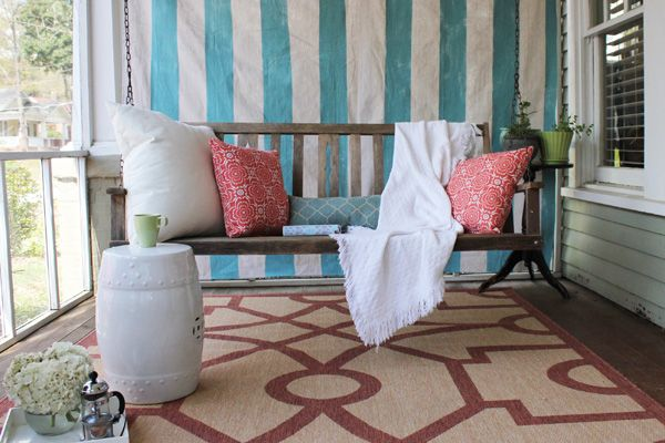 Paint stripes on a drop cloth to create outdoor curtains! #paint #diy | Find full step-by-step tutorial on the Home Depot blog