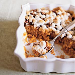 Top this lightened version of the classic sweet potato casserole with both marshmallows and toasted pecans. (For more classic dishes, visit our sweet potato recipes collection.)
