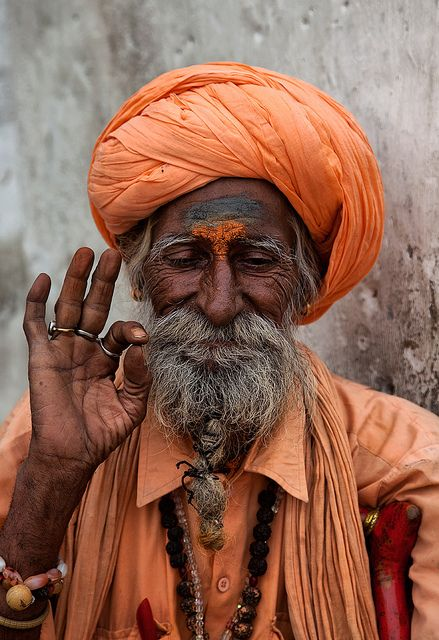 Indian man with lines of time seen in his cheeks.