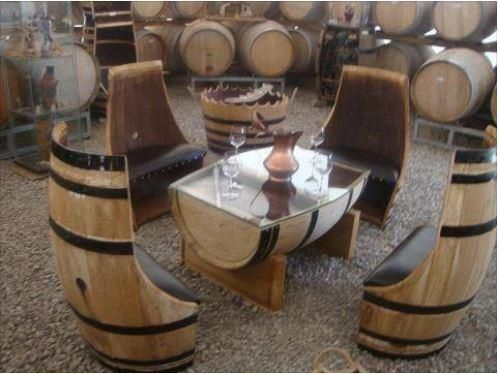 Glass-topped wine barrel coffee table and 4 chairs with leather cushions.: