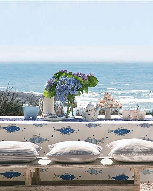 Blues, Creams and Coastal Style - love the bench-style, cushion-topped seating and, of course... the view!