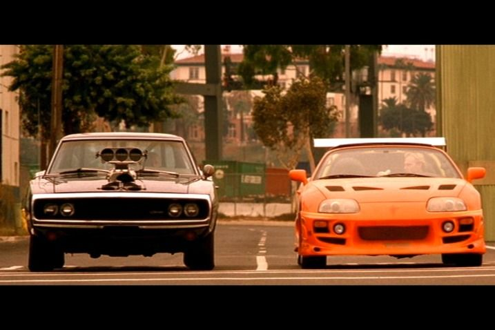 From  The Fast and the Furious we have 1993 Toyota Supra Turbo: It beats a Ferrari on PCH. Then chases a motorcycle. And is given away to Vin Diesel at the end of this 2001 film.