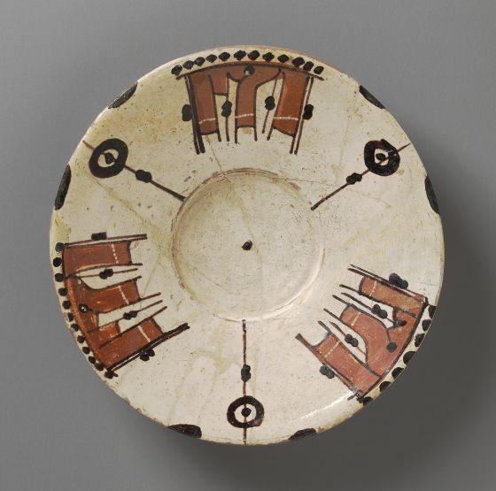 Saucer  Vessel  Persian  ,  11th century  Samanid period, AH 204-395 / AD 819-1005  Creation Place: Nishapur or Samarkand, Iran or Uzbekistan  Slip-painted decoration  4.45 x 20.32 cm (1 3/4 x 8 in.)