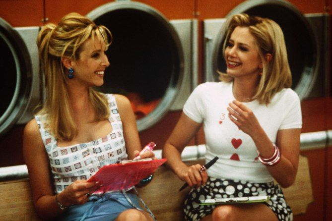 "Thanks to designer Mona May, Romy and Michele's High School Reunion is remembered not only for its wit and music, but also its ""fun, frisky"" costumes."