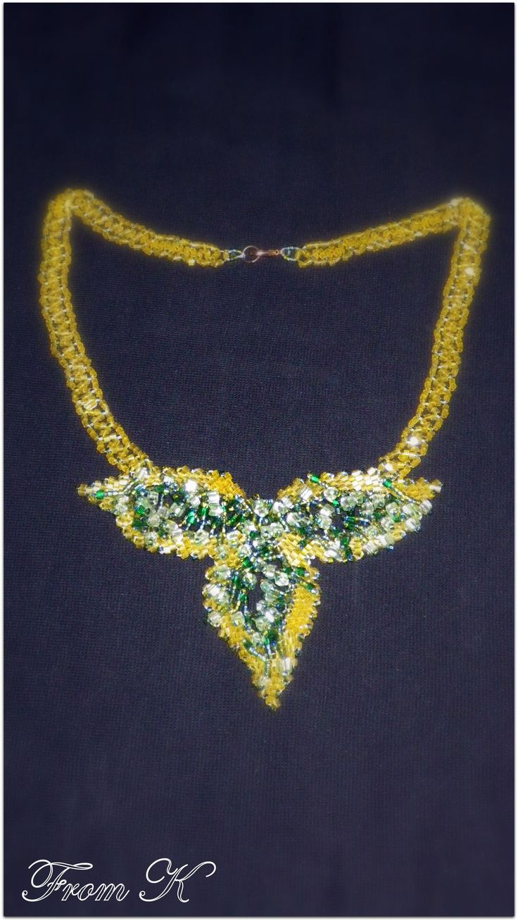 Pretty leaves necklace, peyote stitched is just over 40 cm long (sits on the base of the neck). Czech seed beads are used and decorated with Czech bead crystals. For more, visit my facebook page https://www.facebook.com/media/set/?set=a.255899171103055.81635.246629745363331&type=3