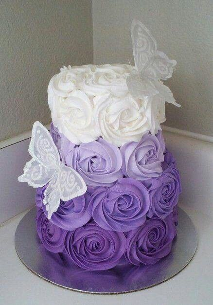 Lavender purple and white, rose tiered cake and white lace butterflies perfect cake for a wedding or birthday.