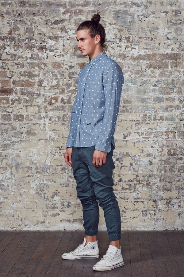 Shop this look on Lookastic:  http://lookastic.com/men/looks/light-blue-chambray-long-sleeve-shirt-navy-sweatpants-white-high-top-sneakers/9667  — Light Blue Polka Dot Chambray Long Sleeve Shirt  — Navy Sweatpants  — White High Top Sneakers