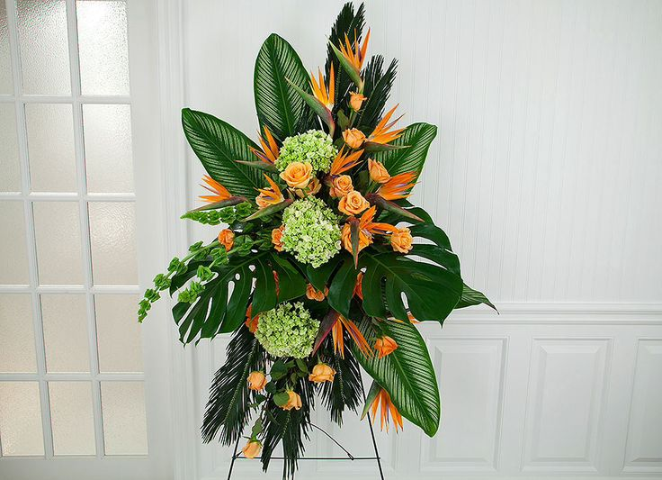 Green and orange includes birds of paradise and bells of Ireland.