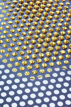 Perforated metal with liquid gold by Lightning and Kingleyface