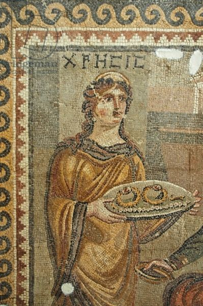 Detail of the mosaic of Chresis, from Daphne (mosaic). captive of Agamemnon, holding a tray with ransom and keys to the city; Roman, (4th century AD) / Antakya Museum, Antakya, Turkey / Ancient Art and Architecture Collection Ltd. / The Bridgeman Art Library