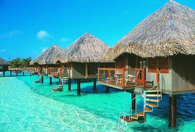 tahiti. ahhh to vacation in a hut in the middle of hthe water...