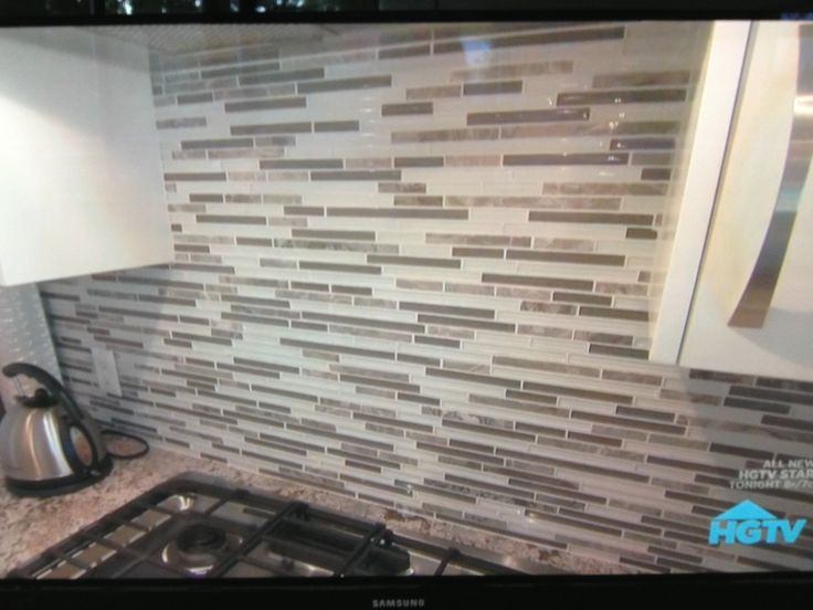 Stone/tile/glass backsplash for a neutral gray kitchen
