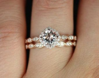 This is almost perfect.  Just replace the diamond with a pearl & have a solid band on the engagment ring