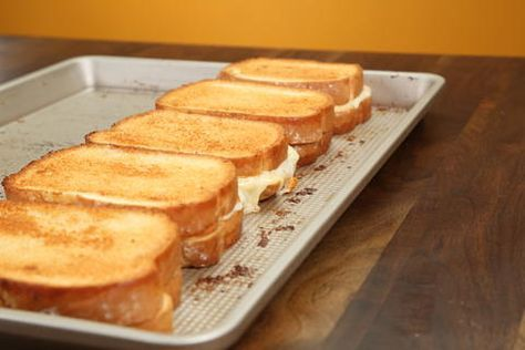 This simple sheet pan technique allows you to make five grilled cheese sandwiches with at the same time (meaning everyone around the table gets an equally gooey and warm sandwich at the same time), and with not much more effort than it takes to prep one. We went with 4 type of cheese—goat, white cheddar, provolone, and Swiss—for these buttery, rich sheet pan grilled cheese sandwiches, but feel free to change the cheeses up depending on what you like or what you have in your fridge. You could…