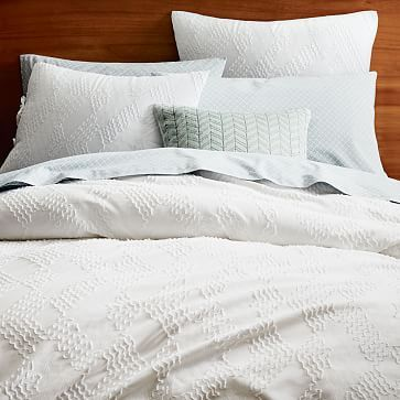 Roar   Rabbit Organic Crisscross Duvet Cover   Shams #westelm simple white bedding with texture. Add one large interesting pillow. Possibly a throw.