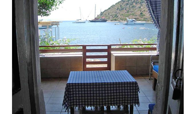 house and villa rentals Bodrum View from inside main living room/ kitchen to downstairs terrace and beach beyond