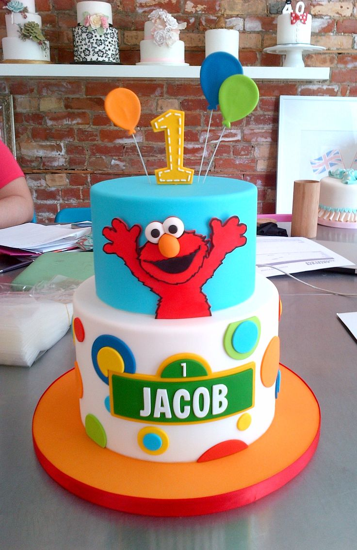 Elmo Surprise Birthday Cake! #Balloons #Sesamestreet #Blue #Red #Orange #Polkadots #LeDolci