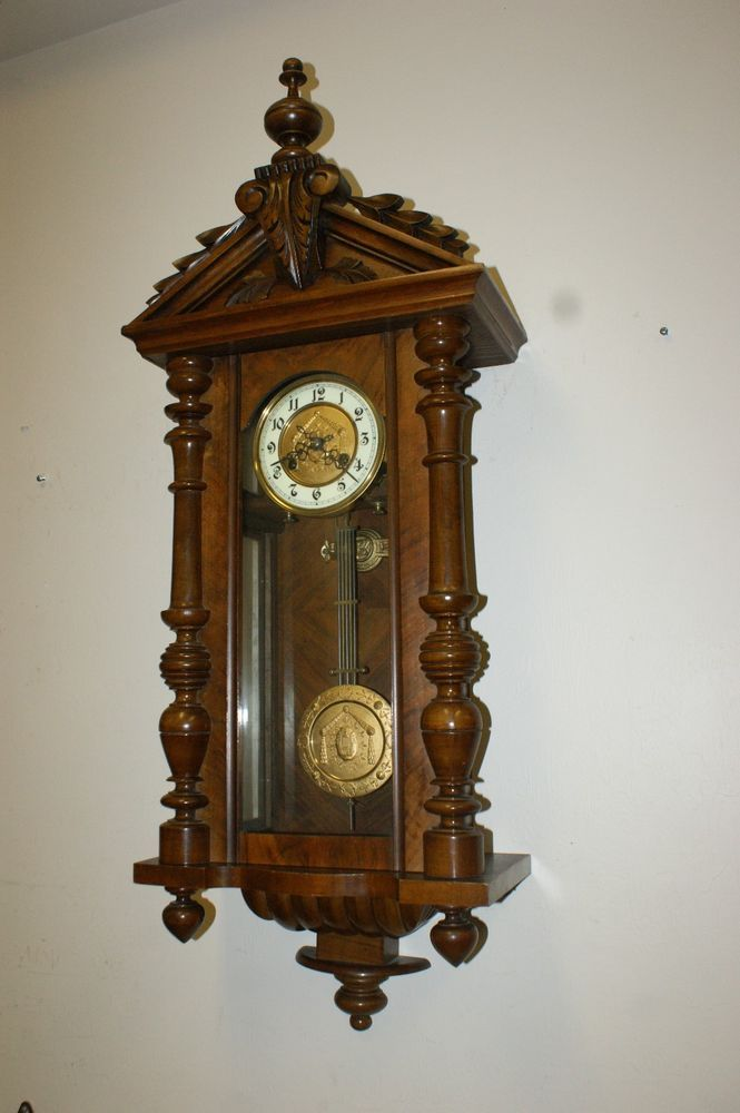Beautiful antique german quarter strike wall clock carved
