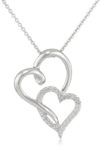 A slightly twisted silver heart playfully loops its way through a diamond-surfaced heart-shape in the Sterling Silver Diamond Double Open Heart Pendant. Indulge your fun sense of fashion with this imaginative accessory, which will intriguingly complement a black cocktail dress. A total of 23 stones graces the second heart.