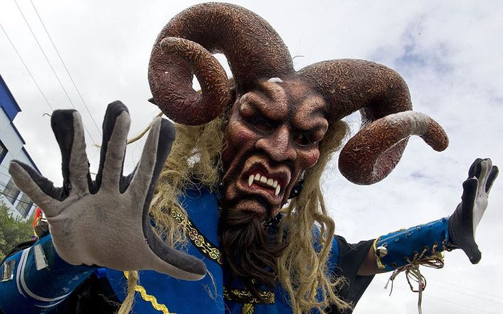 A reveler takes part in the 'White Day' parade during the Blacks and Whites Carnival, in Pasto, Colombia