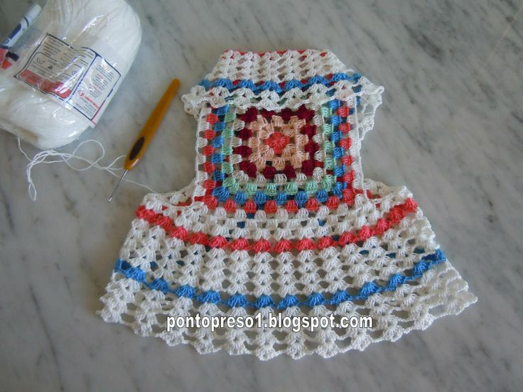 Granny square dress - how cute! Actually, this whole blog is DELICIOUS! A must read - chocka full of new and exciting things!!  Preso1 Point: Crochet - A Coletinho to Ana Cecilia. . .