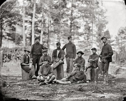 """August 1864. """"Petersburg, Virginia. Group of Company D, U.S. Engineer Battalion."""" Wet-plate glass negative, photographer unknown."""