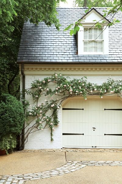 Garage with slate roof, dentil molding, copper gutters, strap hinges, climbing roses
