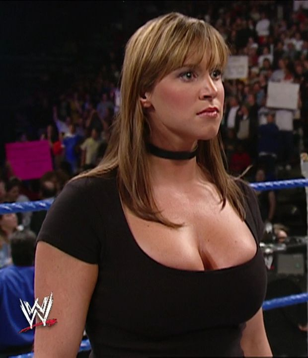 The gorgeous bouncy breasts of the commissioner of raw Stephanie McMahon in a tight black cleavage revealing dress.