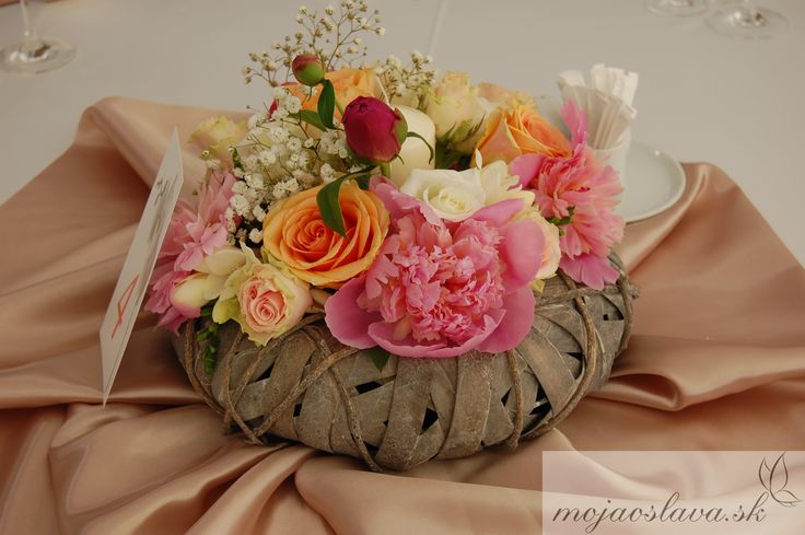 pink paeony with pastel roses and freesia
