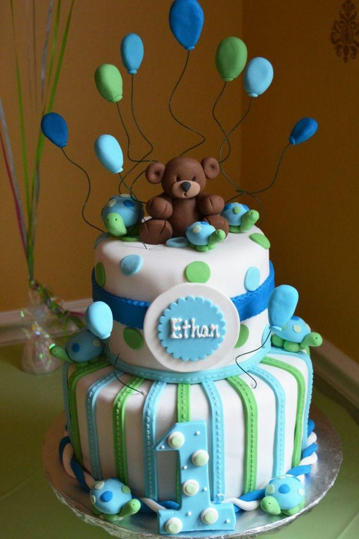 gâteau bébé garçon en bleu,blanc et vert décoré de tortues, ballons et un ourson