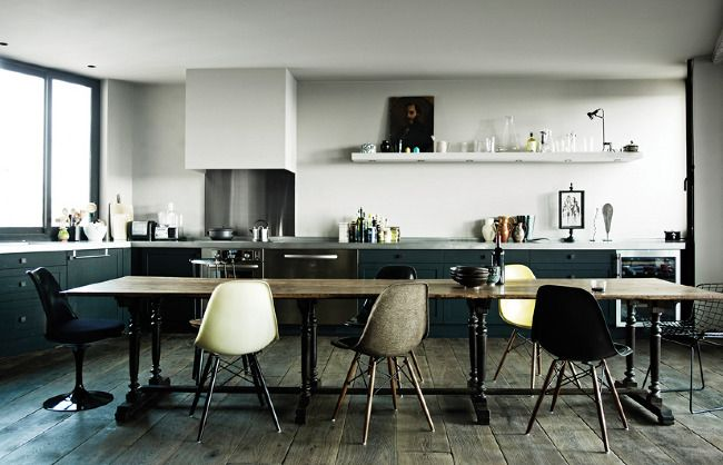 Great kitchen colors. As usual the natural light is what makes the dark tones work. I like the chair colors.