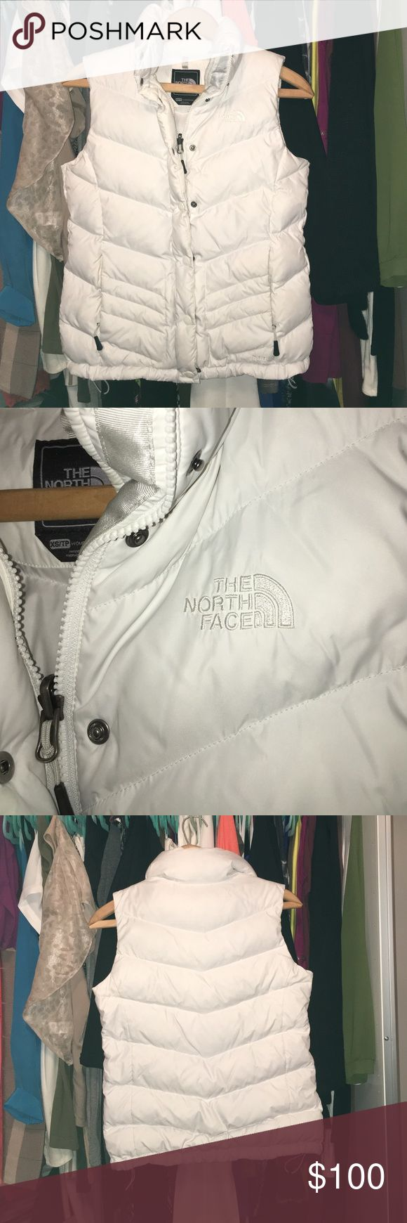North face vest used a couple of times! Super cute sporty white north face vest! The North Face Jackets & Coats Vests