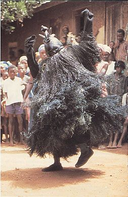 Africa | A performing 'Ndoli jowei'.  Sande society of the Mende people of Sierra Leone. | Image taken from ~ Representing Women Sande Masquerades of the Mende of Sierra Leone;  Ruth B. Phillips; page 104