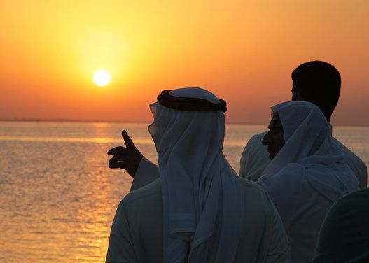 Beautiful Ramadan Photos From Around The World -Bahrainis look for the sliver of a new moon that would indicate the start of the Islamic holy month of Ramadan, while standing on the shore of the Persian Gulf at sunset in the western village of Karzakan, Bahrain