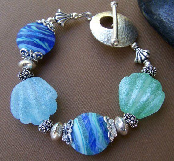 Sea shell lampwork glass and sterling  beaded bracelet.   Stone Street Studio