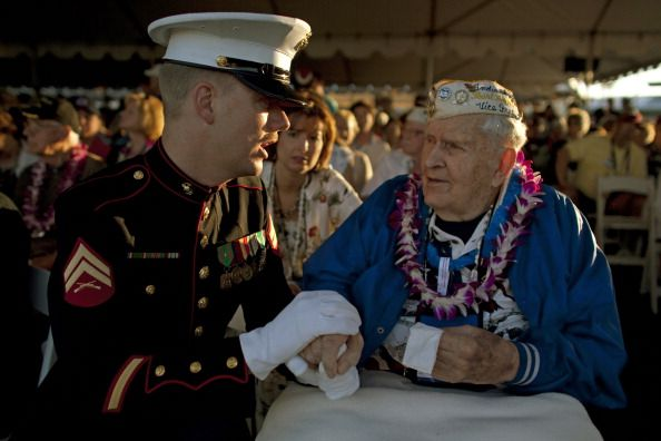 Pearl Harbor Day: U.S. Marine Dwight Hanson talks to Pearl Harbor survivor John Latko during a memorial service for 69th anniversary of the attack on the U.S. naval base at Pearl Harbor on the island of Oahu on December 7, 2010 in Pearl Harbor, Hawaii.