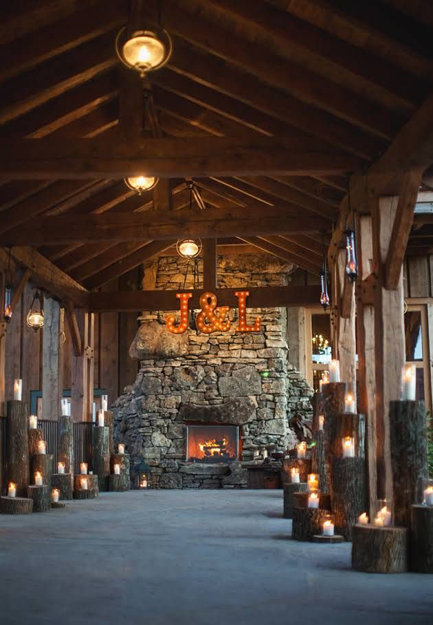 Candles and the couple's initials at a hunting lodge-inspired wedding at Big Cedar Lodge.