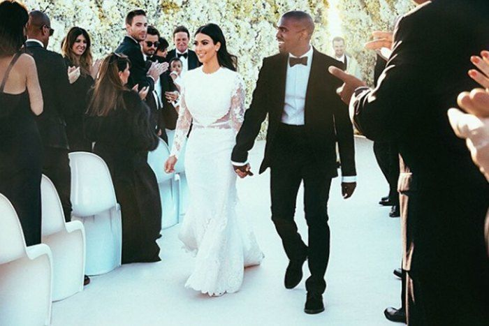 Kim Kardashian and Kanye West For her big (huge!) wedding day with rapper Kanye West, Kim Kardashian wore a Givenchy haute couture gown and ivory satin heels created for the bride by designer Giuseppe Zanotti. #giuseppezanottiheelswedding #giuseppezanottiheelskanyewest