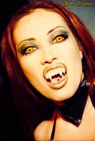 Photo of sexy vampire with fangs