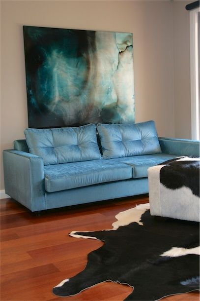 Hollywood Glamour family living.  Custom made sofa and art.