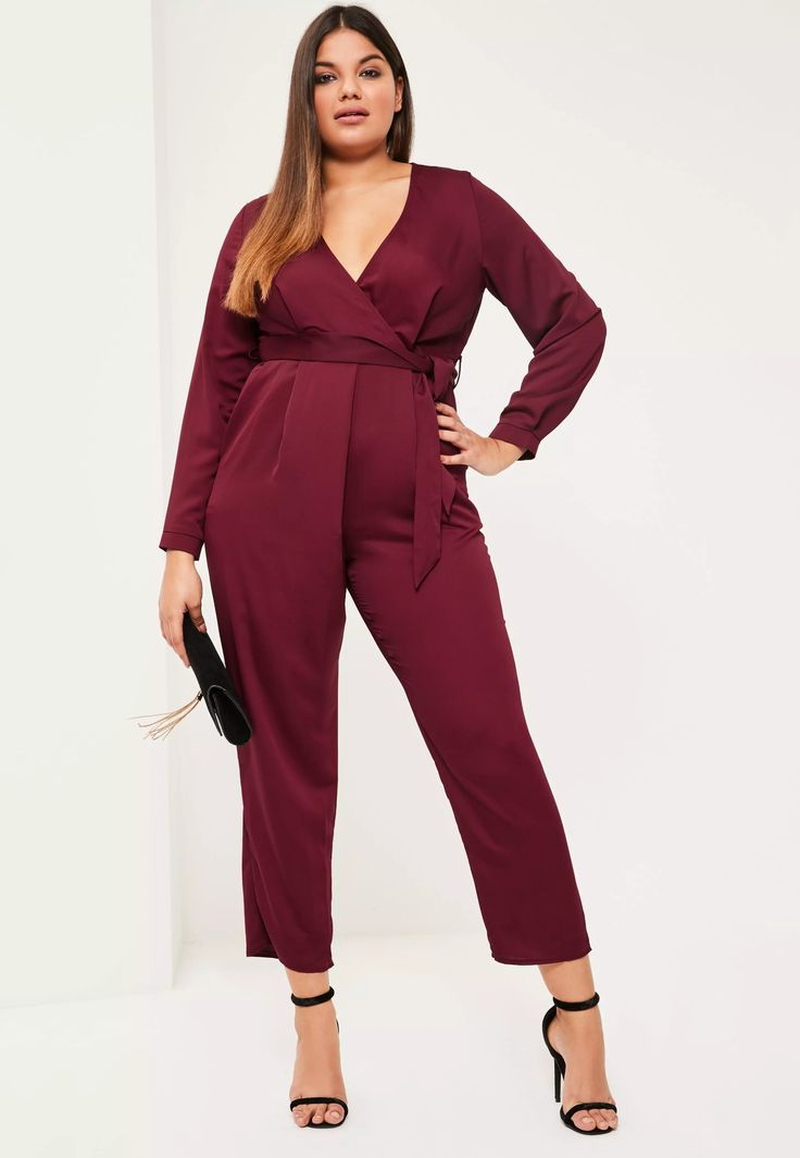 There's nothing sweeter than a jumpsuit and this burgundy beaut with long sleeves and belted finish defo has your name written all over it! in a luxe satin material and wrap over design - all eyes will be on you!