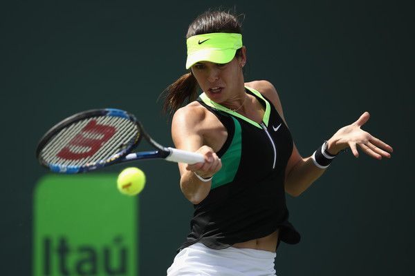 Ajla Tomljanovic Photos Photos - Ajla Tomljanovic of Croatia in action against Lucie Safarova of Czech Republic at Crandon Park Tennis Center on March 25, 2017 in Key Biscayne, Florida. - 2017 Miami Open - Day 6