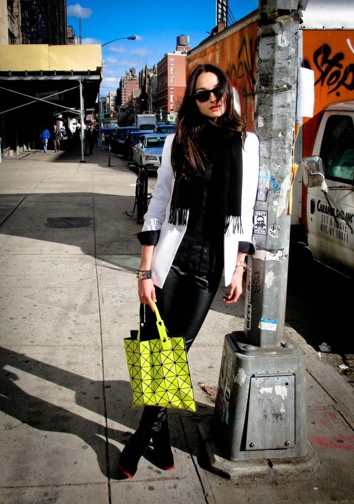Model bruna tenorio wearing a white blazer, black scarf, leather pants, black…