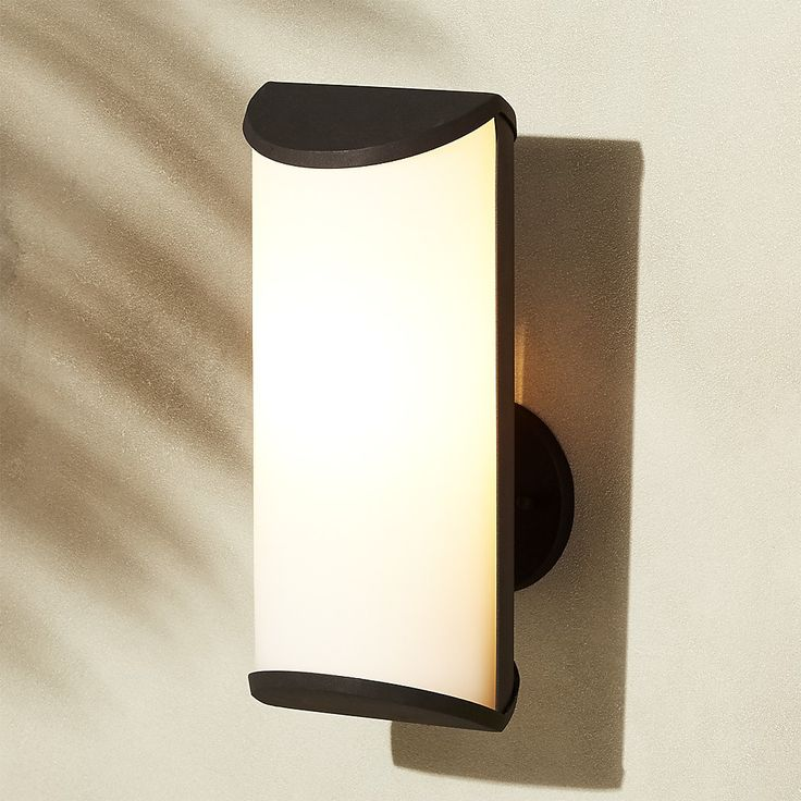 Shop Chamber Black Outdoor Wall Sconce. Black steel outdoor wall sconce takes vertical approach to illumination, with white frosted glass shade that softly diffuses light.
