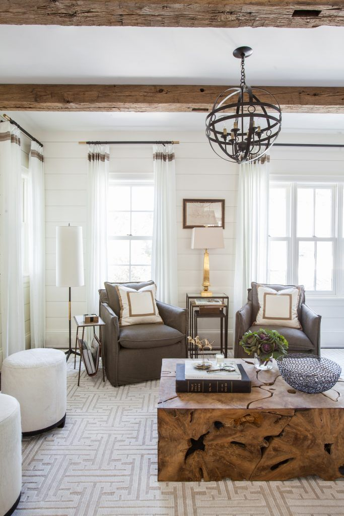 Marie Flanigan Interiors - Benjamin Moore Cloud White Shiplap - Arteriors Hollace Chandelier - Milo Teak Coffee Table - Lee Industries Club Chairs - Arteriors Large Knight Nesting Tables - Interlude Home Strauss Magazine Table - Stark Dorjee Collection Rug