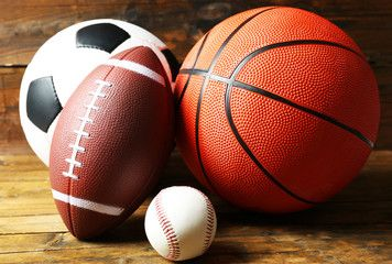 Sports Balls On Wooden Background Sports Basketball Photos Football And Basketball