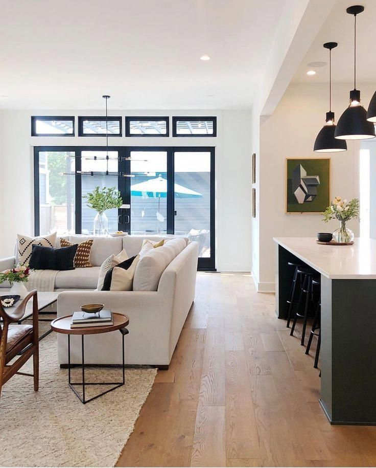 White Walls Create A Spacious Atmosphere Compliment It With Cream Colored Couch Living Room And Kitchen Design Open Concept Living Room Beautiful Living Rooms