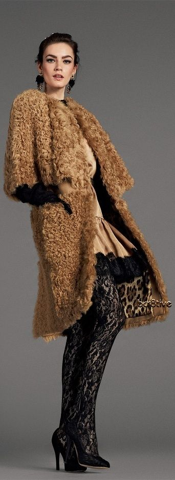Dolce and Gabbana - love the coat! Goes so well with the tights